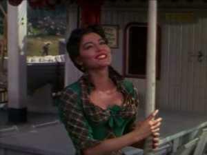 (A very tan) Ava Gardner as Julie